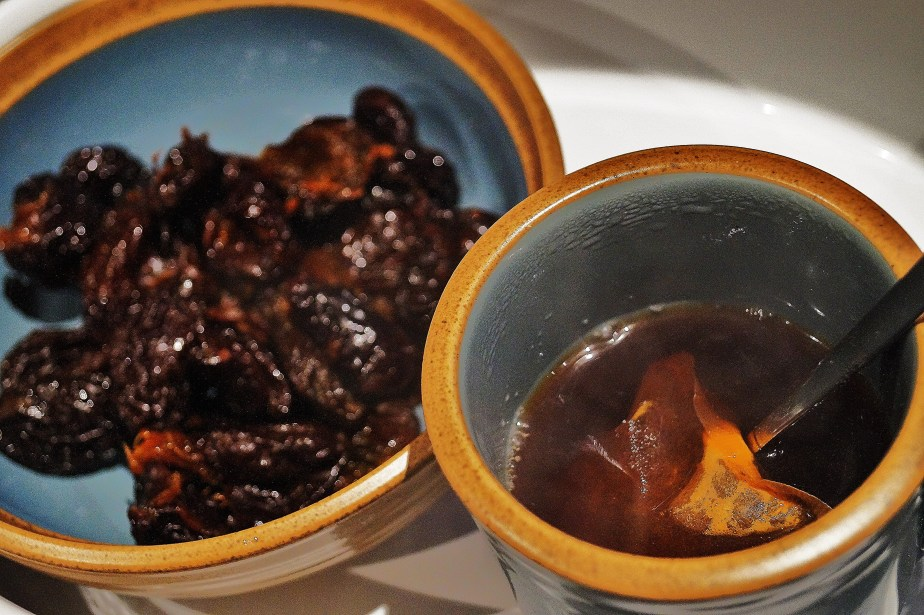 Soak the prunes with rum and tea